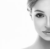 Beautiful woman half face close up studio on white Royalty Free Stock Photos