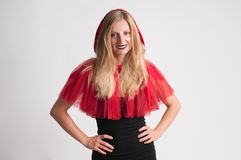 Beautiful woman in halloween costume Little Red riding hood. On white background Stock Images