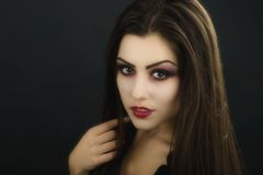Beautiful woman with halloween makeup isolated on black backgrou Stock Images
