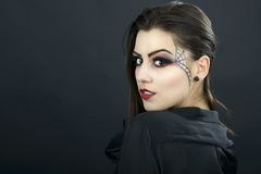 Beautiful woman with halloween makeup isolated on black backgrou Royalty Free Stock Images