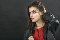 Beautiful woman with halloween makeup isolated on black backgrou Stock Image
