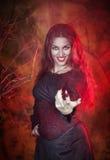 Beautiful woman in halloween style beckoning finger. Beautiful woman with long hair in halloween style beckoning finger stock photo