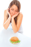 Beautiful woman with hamburger. On a white background Stock Photography