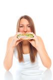Beautiful woman with a hamburger Stock Images
