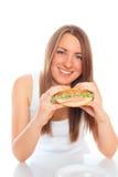 Beautiful woman with a hamburger. On a white background Stock Photo