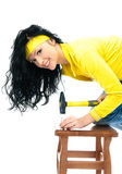 Beautiful woman with a hammer Stock Photo