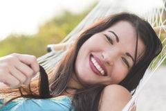 Beautiful woman in hammock. A beautiful woman laying in a hammock. A close up portrait Stock Photos