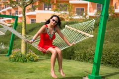 Beautiful woman on the hammock Stock Photos