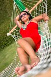Beautiful woman on the hammock Stock Image