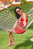 Beautiful woman on the hammock Stock Photography
