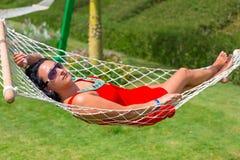 Beautiful woman on the hammock Stock Photos