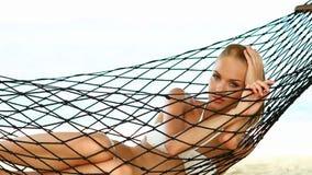 Beautiful woman in hammock stock video footage