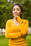 Beautiful woman with hand on chin in park Royalty Free Stock Image