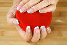 Beautiful woman hand with france manicure Royalty Free Stock Image