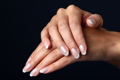 Beautiful woman hand with french manicure Stock Photography
