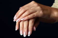 Beautiful woman hand with french manicure Royalty Free Stock Image