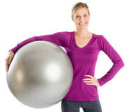 Beautiful Woman With Hand On Hip Holding Fitness Ball Royalty Free Stock Photos