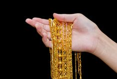 Woman hand hold gold necklace jewelry, Accessory and f stock photos