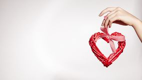 Woman Hand Keep Wooden Heart. Heart on White Background with Copy Space. Love, Family. Valentine`s Day concept.
