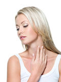 Beautiful woman with hand on neck Stock Photography