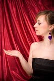 Beautiful woman with hand ready for product placement royalty free stock images