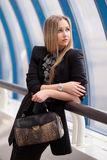 Beautiful woman with a  handbag Royalty Free Stock Images