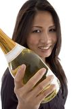 Beautiful woman handling Champagne bottle Stock Photography