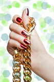 Beautiful woman hands with chain isolated on white Stock Image