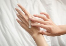 Beautiful woman hands. With cream Royalty Free Stock Photos