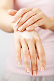 Beautiful woman hands with cream Stock Photography