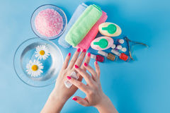 Beautiful woman hands with cream Stock Photos