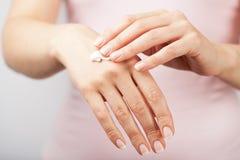 Beautiful woman hands with cream Stock Photos