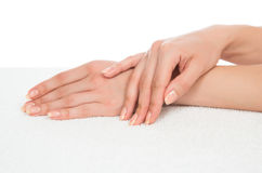 Beautiful woman hands with french manicure nails Royalty Free Stock Photos