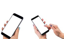 Beautiful Woman hands holding two smart phone with isolated white screen. Business workplace with copy space. Empty space for text. Isolated screen for mock up Stock Photography