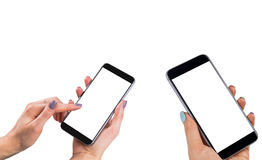Beautiful Woman hands holding two smart phone with isolated white screen. Business workplace with copy space. Empty space for text. Isolated screen for mock up Stock Photos