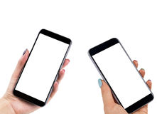 Beautiful Woman hands holding two smart phone with isolated white screen. Business workplace with copy space. Empty space for text. Isolated screen for mock up Royalty Free Stock Photos