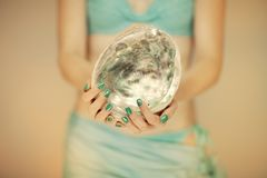 Beautiful woman hands with perfect blue nail polish holding abalone shell, happy bikini beach mood. Can be used as background stock photography