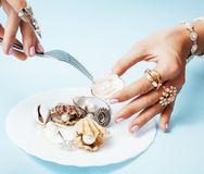 Beautiful woman hands with pink manicure holding plate with pearls and sea shells, luxury jewelry concept Stock Image