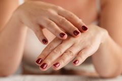 Beautiful Woman Hands. Spa Manicure concept. Soft skin, skincare Stock Photos