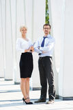 Beautiful woman and handsome man being business partners Stock Photos