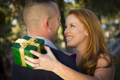 Beautiful Woman and Handsome Military Man Exchange Royalty Free Stock Photos