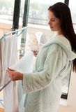 Beautiful woman hanging clothes Royalty Free Stock Photography