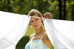Beautiful woman hanging clothes Stock Photography