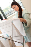 Beautiful woman hanging freshly washed clothes on the rack Royalty Free Stock Images