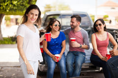 Beautiful woman hanging out with friends Royalty Free Stock Photography