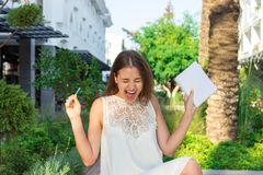 Beautiful woman is happy because of crazy idea which she has during writing some thoughts stock photos