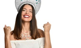 Beautiful woman happy and excited expressing winning gesture. Successful and celebrating victory, triumphant, outdoor royalty free stock photography