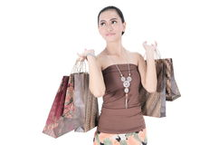 Beautiful woman happy holding shopping bags Royalty Free Stock Images