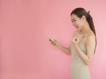 beautiful woman happy when use smart phone,asian girl use moblie phone royalty free stock photography