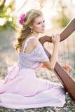 Beautiful woman with harp Royalty Free Stock Photos